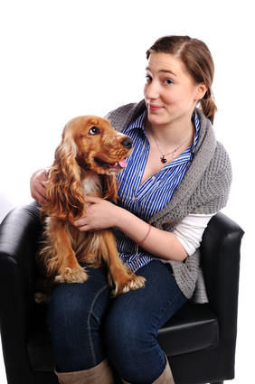 girl with cocker spaniel on lap